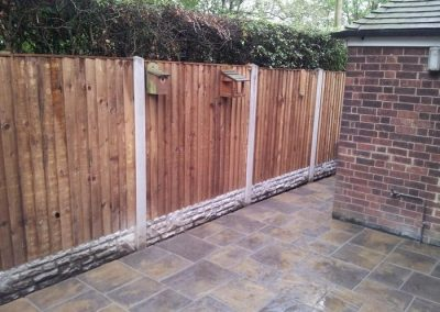 large_Close Board Panel Fence with concrete slotted post and rock faced gravel board