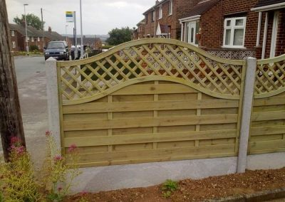 large_Omega continental fencing panel with concrete slotted post and plain gravel board